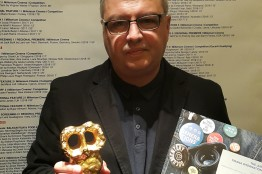 Stefan-Kitanov-with-Award.jpg